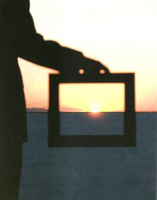 holding-frame-with-sunset